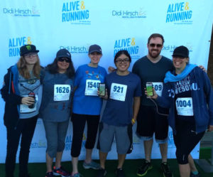 Alive and Running 5k front of six participants